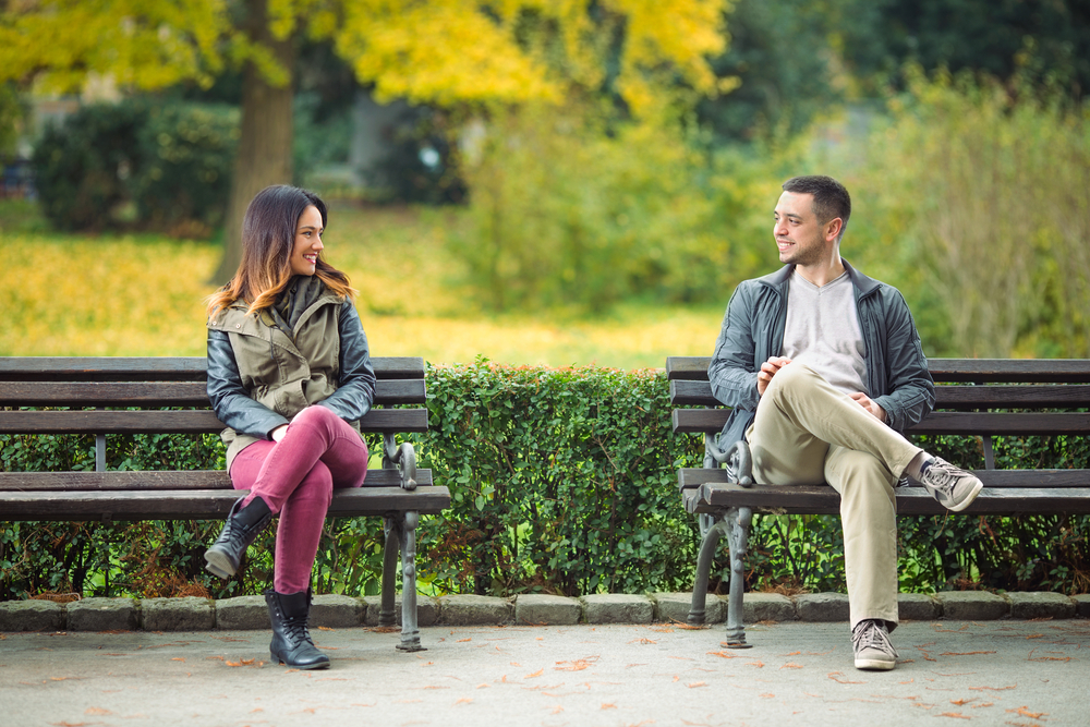 Love at glance on benches in a park